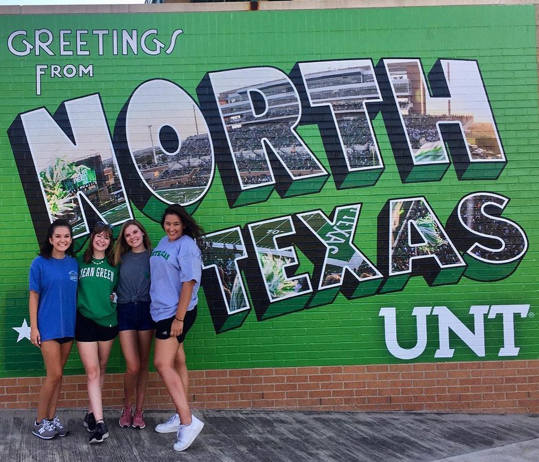 Students standing in front of North Texas mural